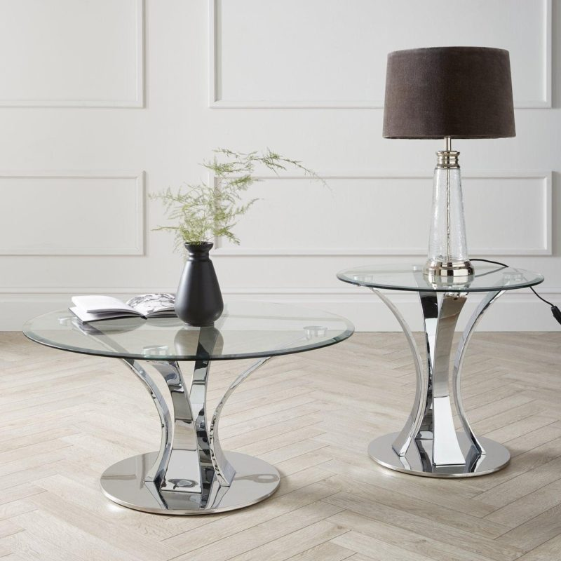 Circular glass and chrome coffee table with matching lamp table