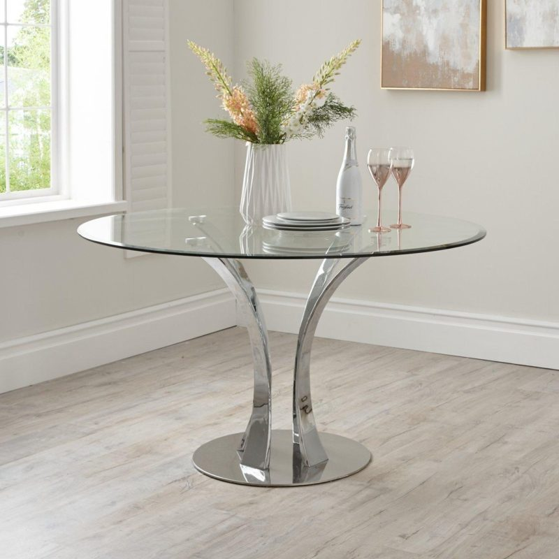 Glass topped circular dining table with chrome stem frame