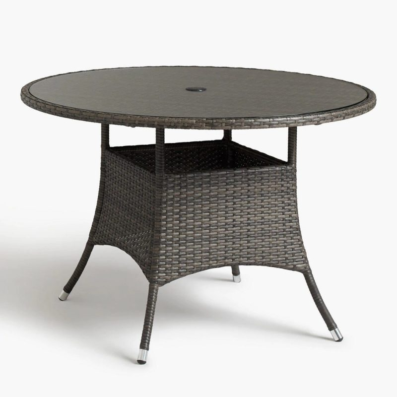 Rattan dining table with round glass top