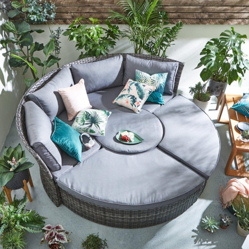 Round rattan day bed with grey cushions