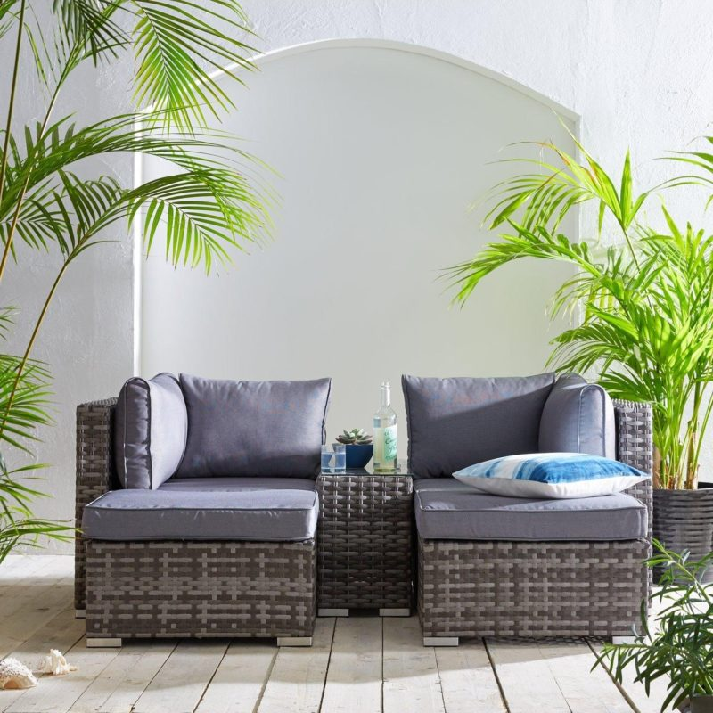 2-seater outdoor sofa with footstools and table