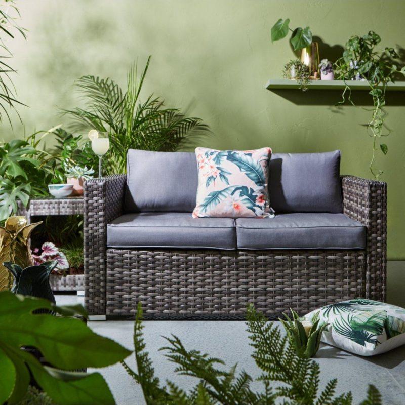 2-seater rattan sofa with grey fabric cushions