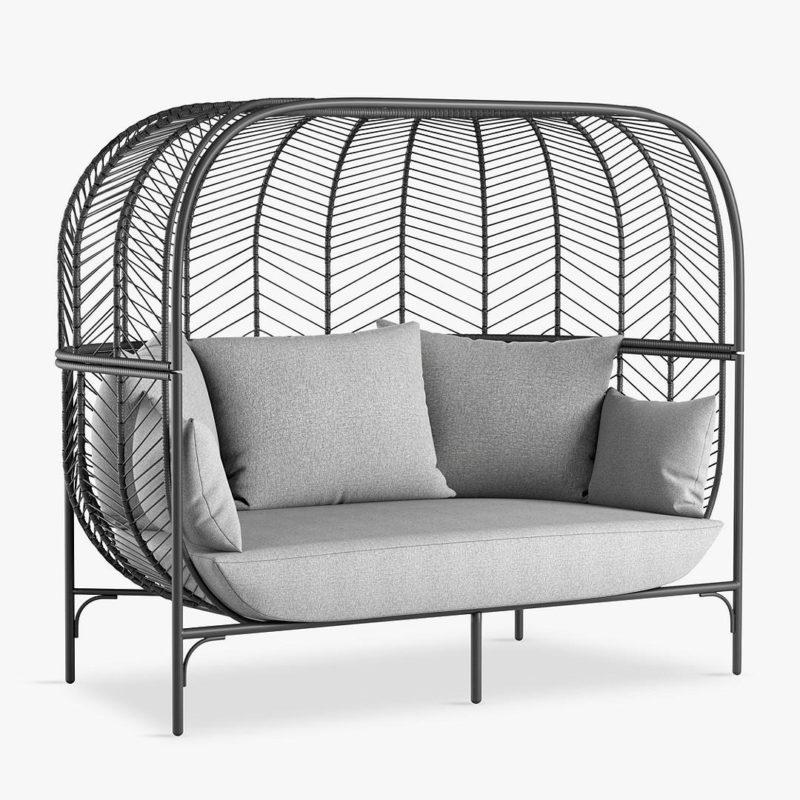 Black rattan pod-style sofa
