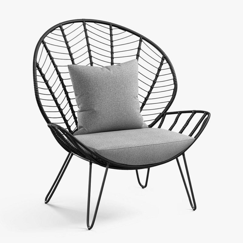 Black rattan chair with large rounded backrest