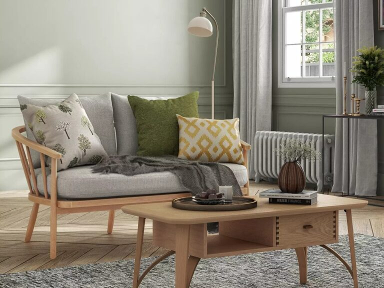 Wooden frame sofa with grey fabric covered cushions