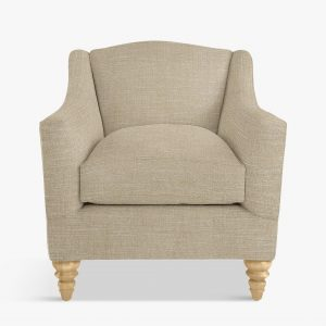 Caramel coloured fabric upholstered armchair