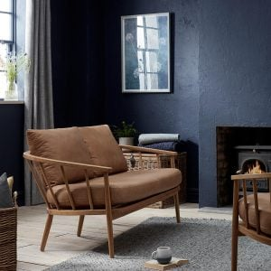 Tan leather sofa with wood frame