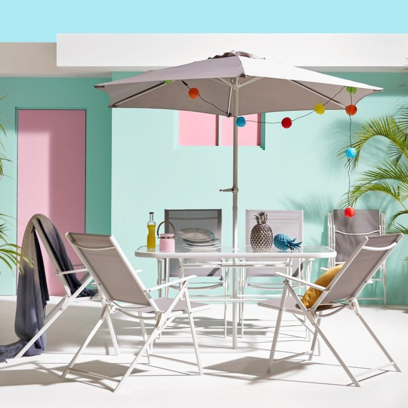 White metal outdoor dining set with grey trim and parasol
