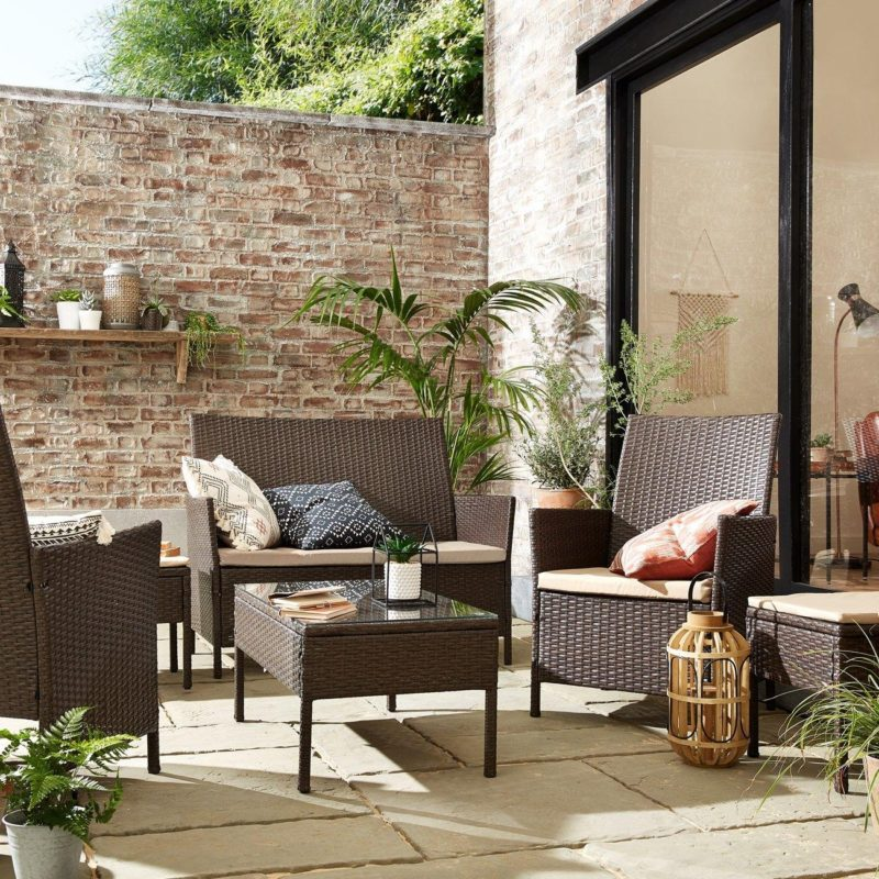 Rattan sofa, 2 chairs a table and 2 footstools