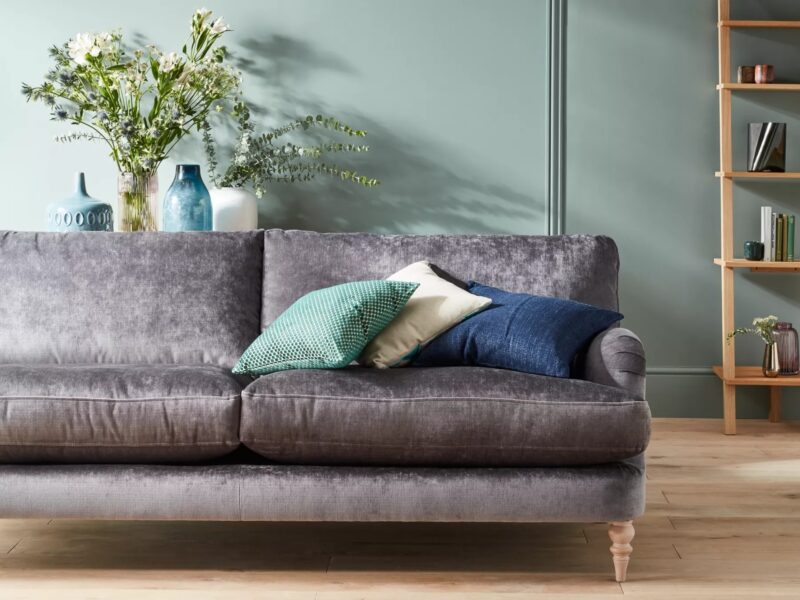 Grey fabric sofa with turned wooden legs
