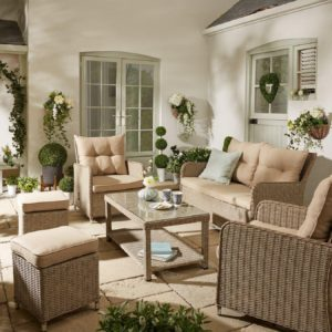 Rattan sofa and armchairs with matching coffee table