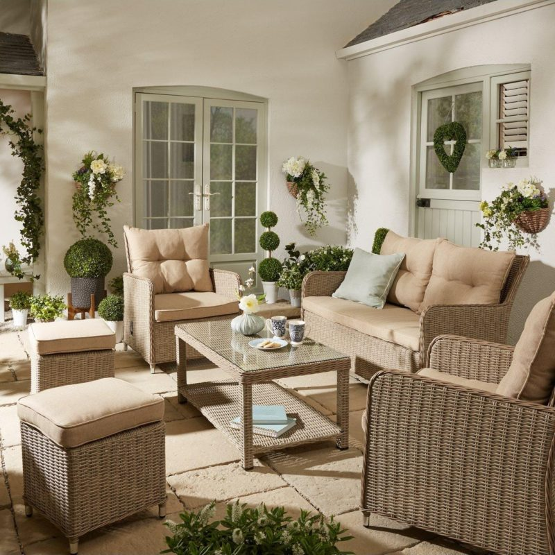 Rattan sofa and armchairs with matching coffee table and footstools