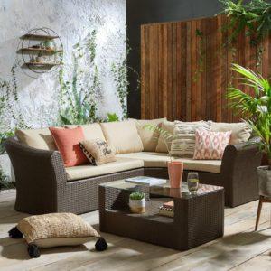 Synthetic rattan corner sofa set with cream cushions