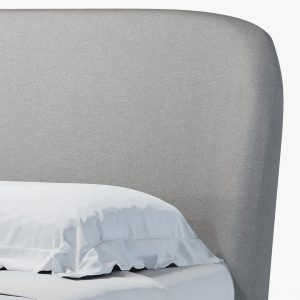 Curved headboard with grey fabric upholstery