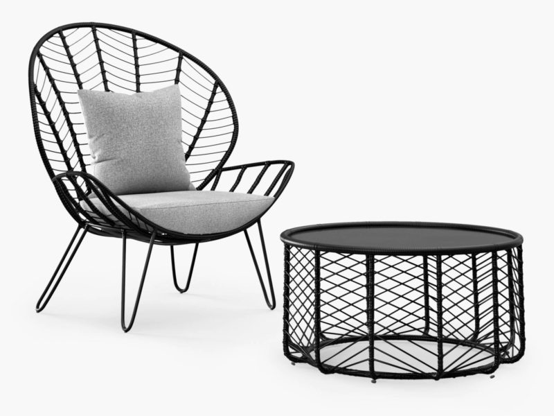 Black rattan garden chair and matching coffee table