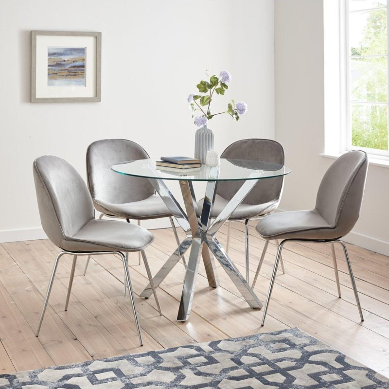 Glass dining table with 4 grey velvet chairs