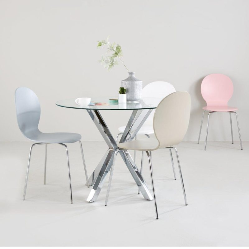 Round glass dining table with polished chrome chopstick legs