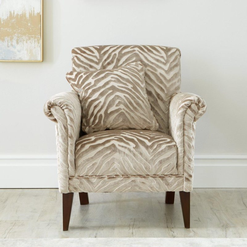 Natural coloured armchair with animal print upholstery