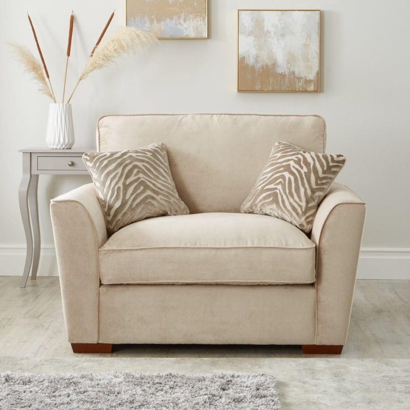 Natural fabric cuddle chair with animal print accent cushions