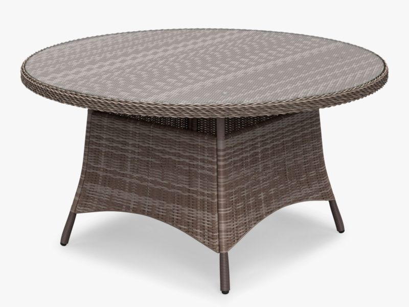 Round wicker dining table with glass top