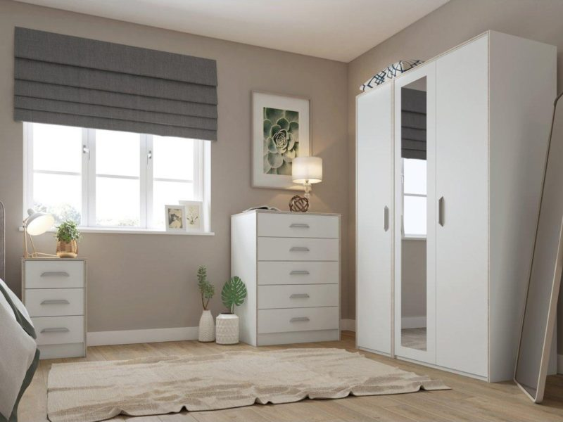 White bedroom furniture with wood grain trim and large silver-coloured handles