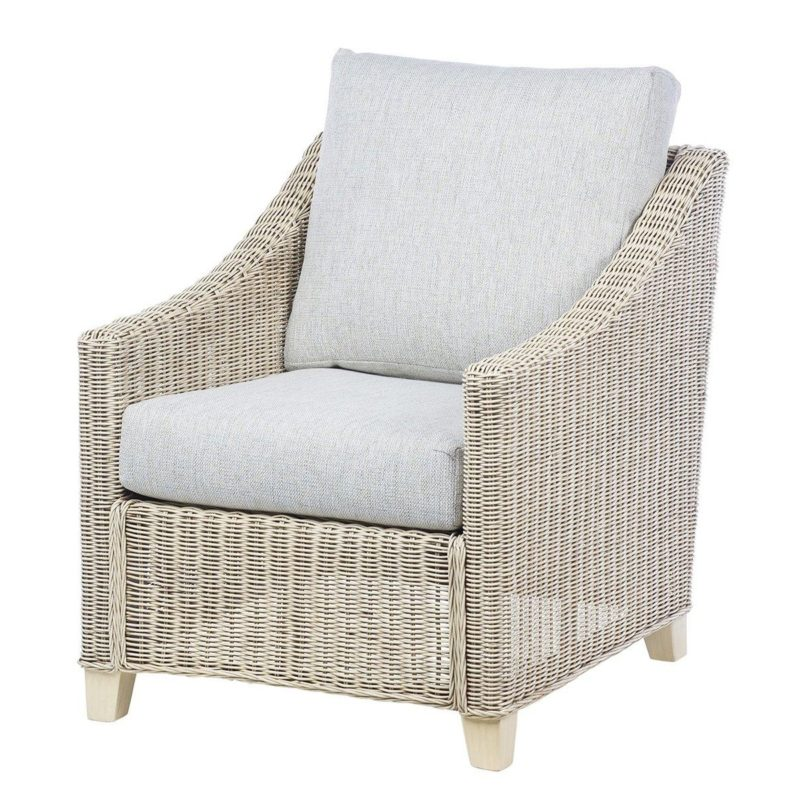Natural rattan armchair with grey cushions