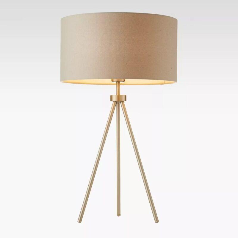 Slender metal tripod-framed tripod lamp with shade