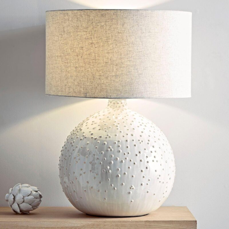 Table lamp with textured, glazed ceramic base