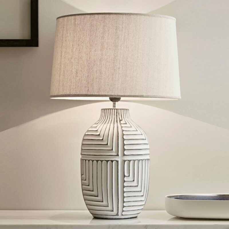 Geometric pattern lamp base with a linen shade