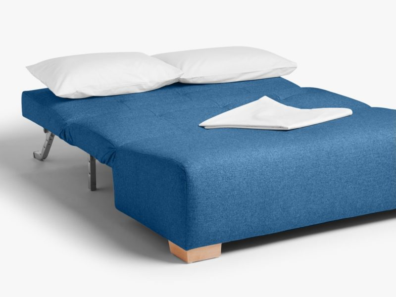 Blue fabric sofa bed laid flat