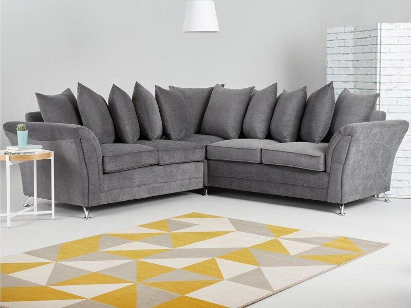 Grey fabric corner sofa with scatter back cushions