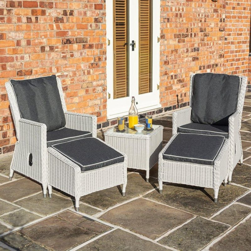 Pair of garden lounging chairs with table