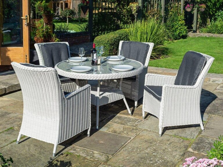 Round white rattan dining table and 4 matching chairs