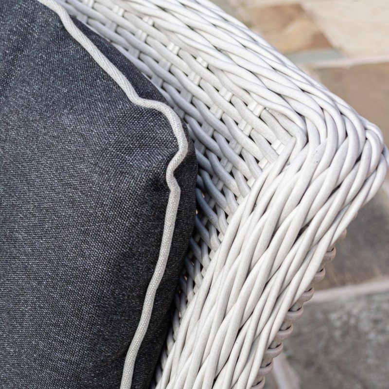 Woven rattan and grey cushion