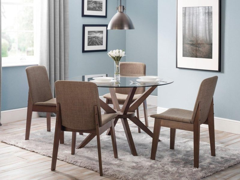 Round glass table and 4 fabric upholstered dining chairs