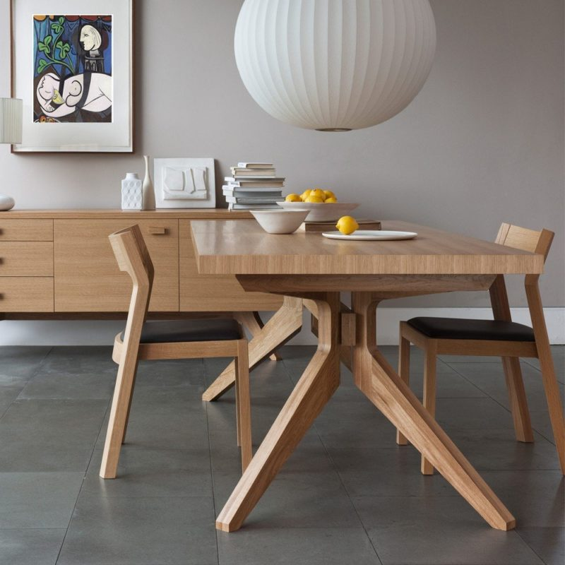 Contemporary oak dining table, chairs and sideboard
