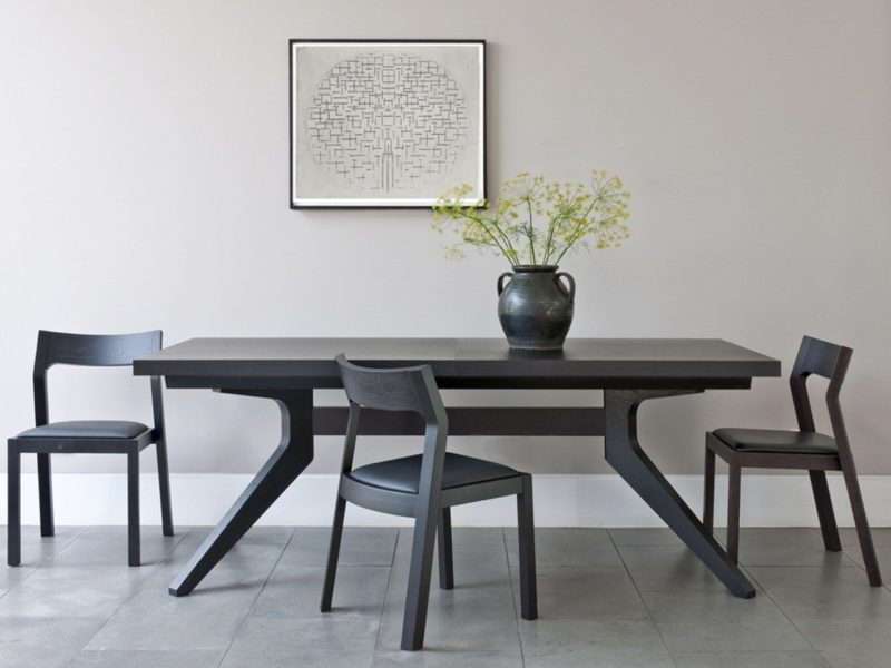 Extending dining table with black-stained finish