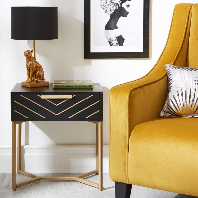 Black painted side table with gold chevron pattern finish