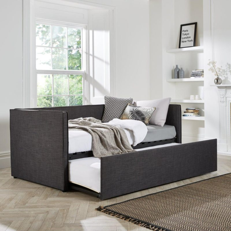Fabric upholstered day bed with pull-out guest bed