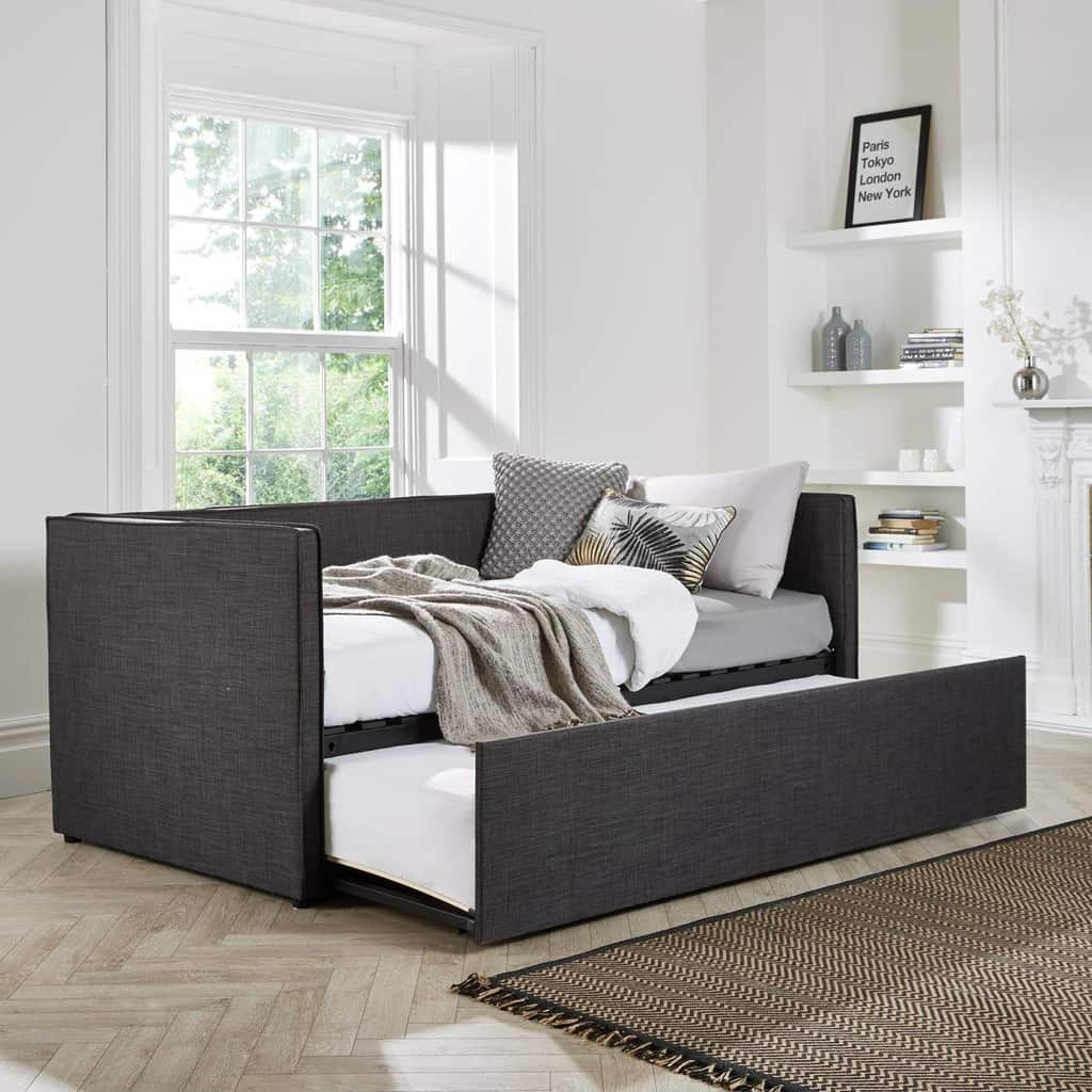 Fabric upholsterd day bed with pull-out guest bed