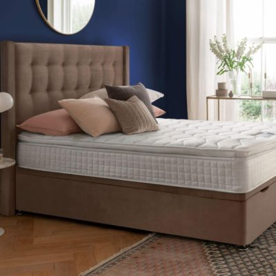Velvet upholstered storage bed with topper mattress