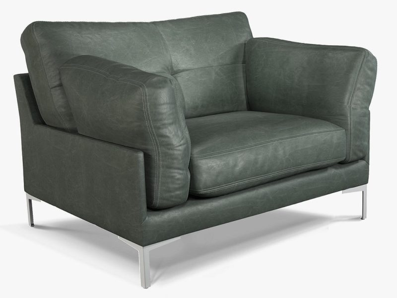 Green leather upholstered armchair with metal base