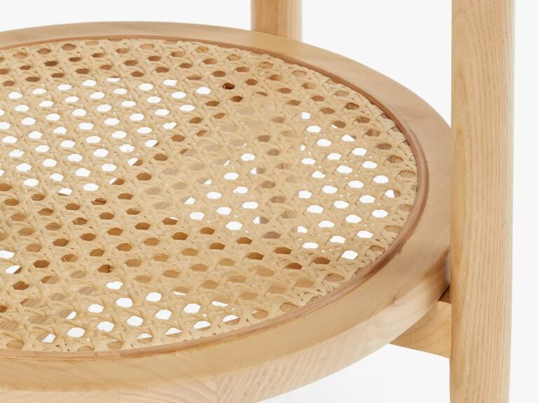 Round oak side table with woven cane shelf