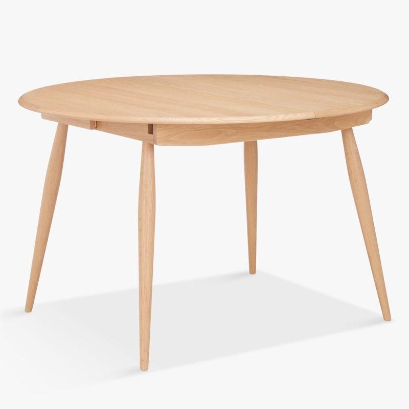 Circular oak extending dining table