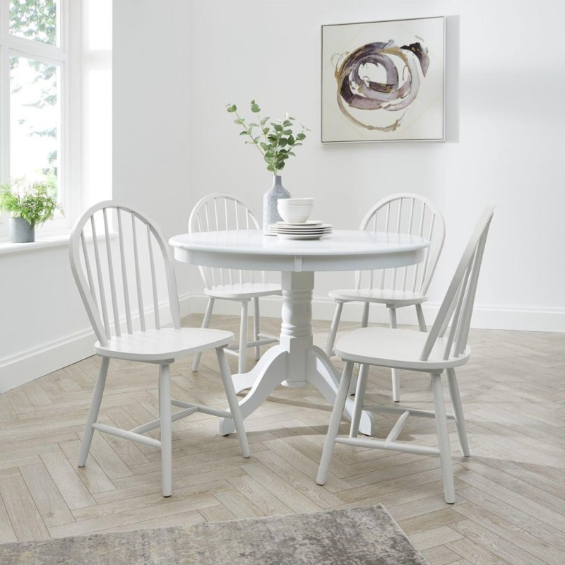 White painted circular dining table with 4 matching chairs