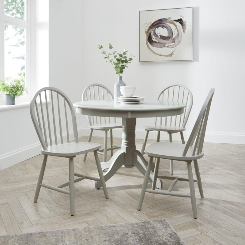 Round grey-painted dining table with 4 chairs