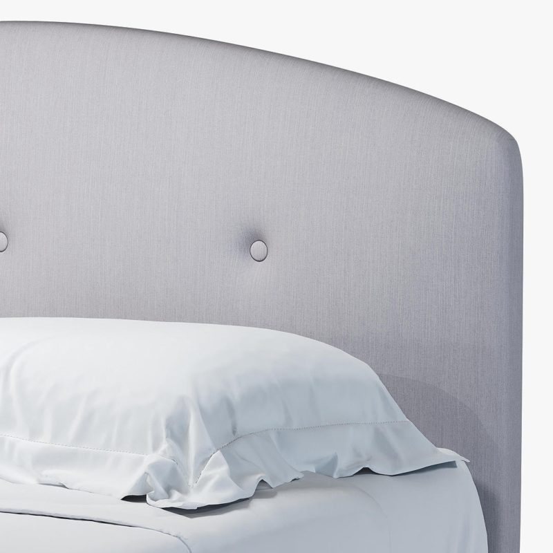 Rounded headboard with fabric upholstery