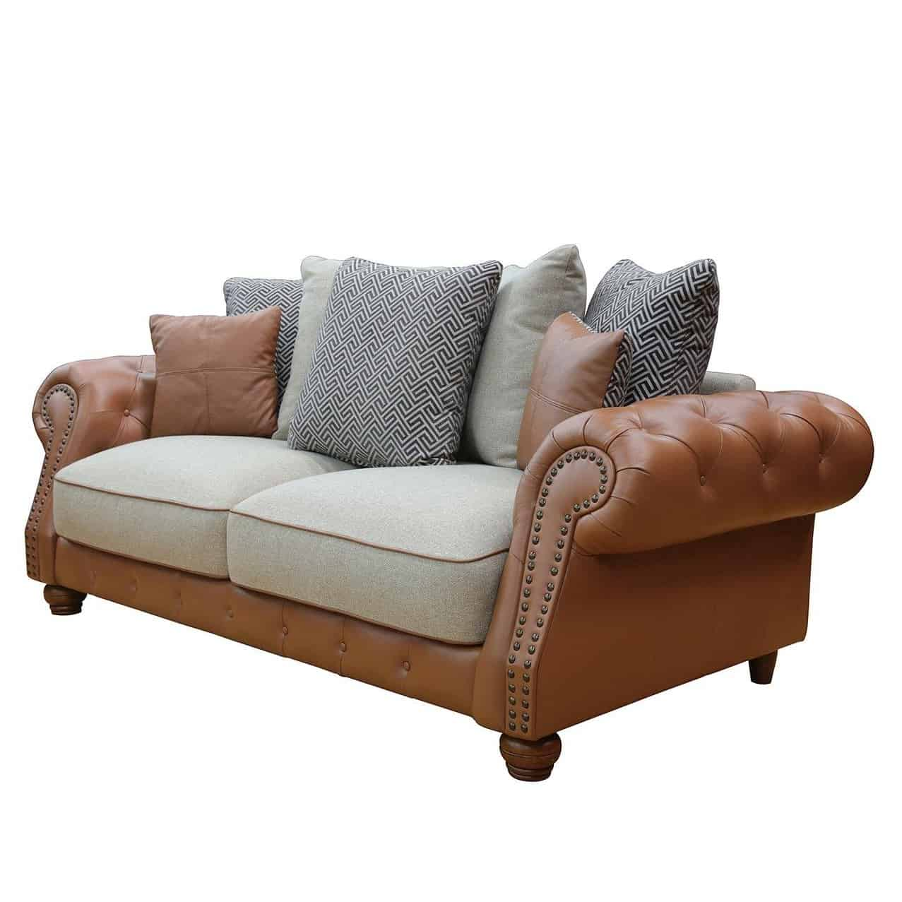 Tan leather and fabric sofa with scatter back cushions