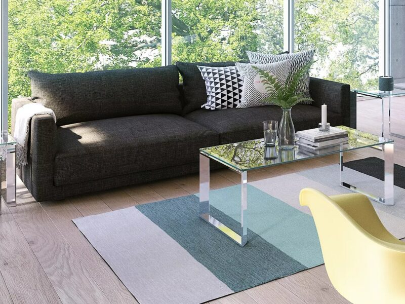 Glass-topped coffee table with polished metal frame