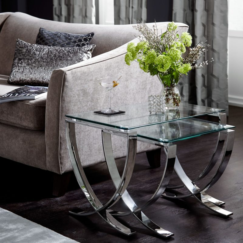 Glass side tables with polished metal legs